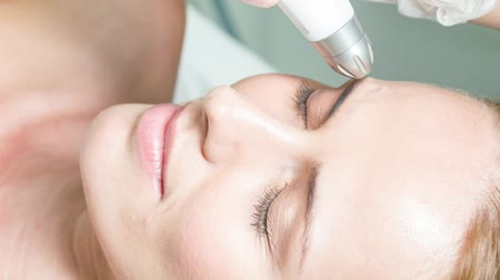 Relaxed girl getting facial rejuvenation procedure Stok Video