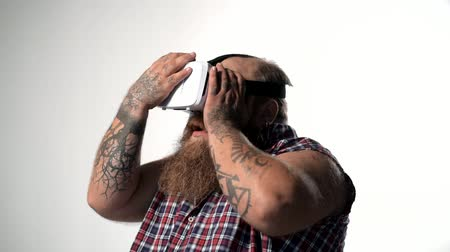 Thick guy entertaining with vr headset