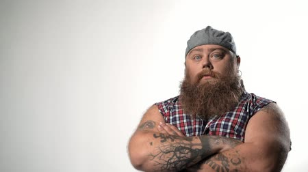 Cool fat male hipster with cap