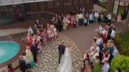 shooting from a drone of the bride goes to her husband