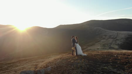 Happy bride and groom in the background of mountains Stock mozgókép