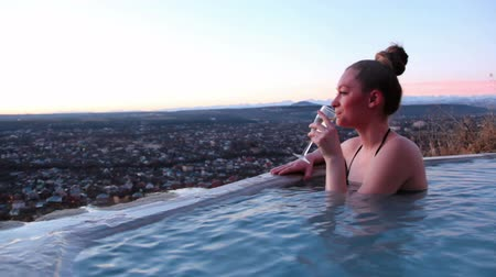 champagne pool : The female in the resort, bathed in a hot spring. Drinking champagne. Stock Footage