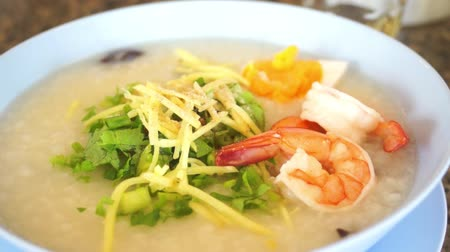 gruel : Rice porridge with shrimp, Thai breakfast, dolly shot Stock Footage