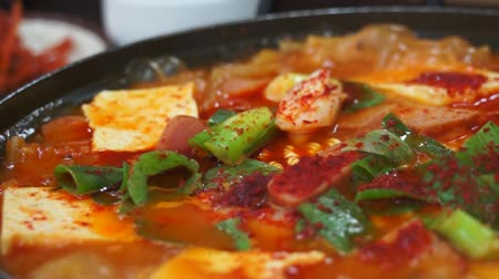 korejština : Kimchi Jjigae or Kimchi Soup, Korean Popular Recipe with hot plate boiling