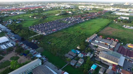 arrabaldes : Many housing project opening in urban areas in asia developing countries, aerial view
