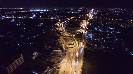 útkereszteződés : Aerial View of overpass u-turn road in thailand suburb, night scene