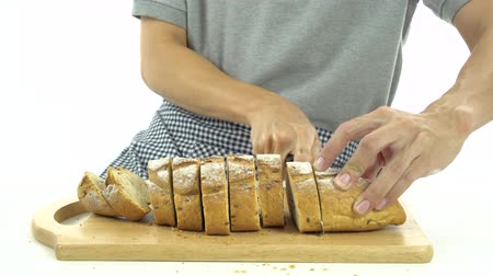 otruby : Slicing baguette on chopping board, Dolly shot