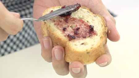 otruby : Spreading jam on baguette, bread, slow, super slow