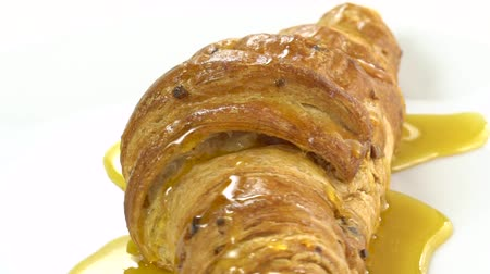 kruvasan : Croissant with honey, rotating, slow, super slow