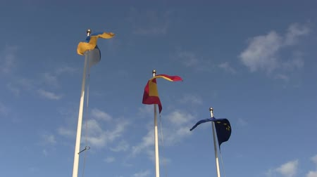 európa : Flags of Europe, Spain and the Canary Islands, blowing in the wind.