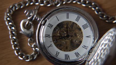 antika : Old silver pocket watch with the second hand moving.