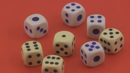 unlucky : Dice that are used in games and for gambling rotating on a red background.