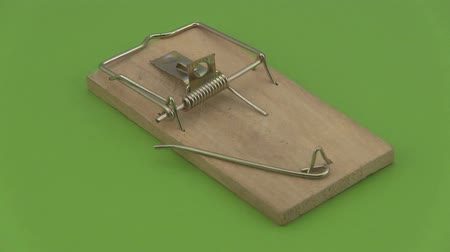 rotační : Wooden mouse trap rotating on a green background.