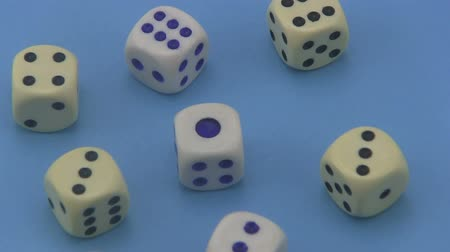unlucky : Dice that are used in board games and for gambling rotating on a blue background. Stock Footage