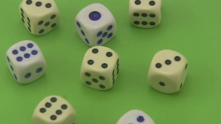 unlucky : Dice that are used in board games and for gambling rotating on a green background. Stock Footage