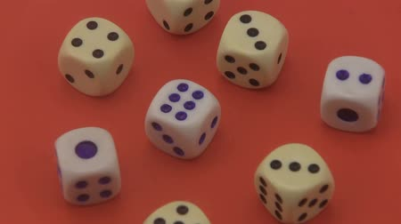 unlucky : Dice that are used in board games and for gambling rotating on a red background.