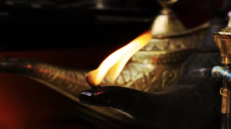 lampa naftowa : Magical Lamp of Aladdin. Arabic Oil Lamp with flames coming out of its nose. Wideo