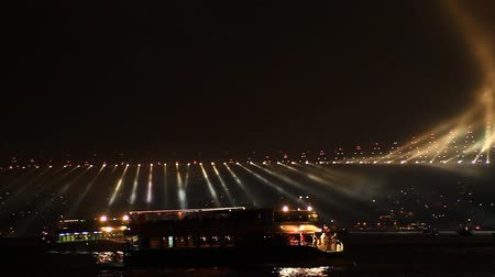 the suspension bridge : October, 29 festival in Istanbul. Running lights on Bosporus Bridge