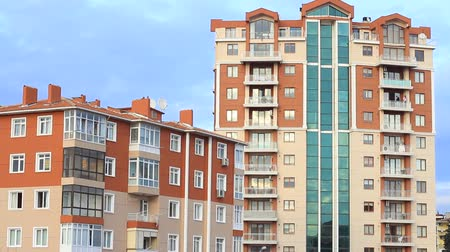 properties : Apartment building. Multistoried modern and stylish living block of flats Stock Footage