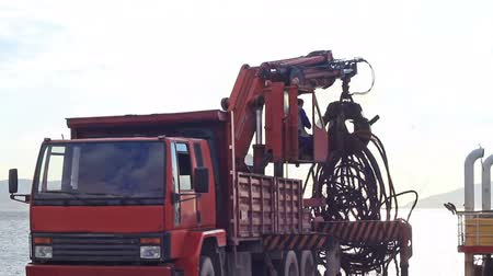 yards : Truck crane lifting up scrap rebars  Stock Footage