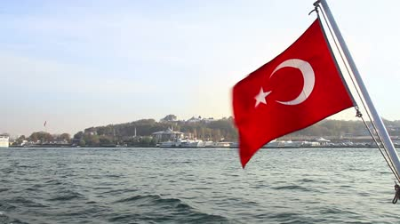 turecko : Turkish Flag waving in front of Istanbuls historical peninsula