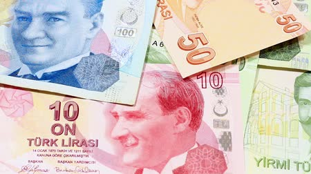 lira : Losing Money. Reverse motion of Turkish banknotes falling against white background.