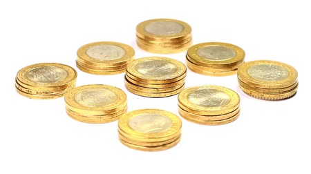 ekonomi : Stacks of golden coins rotating over white. Rotating golden coin stacks. Loop