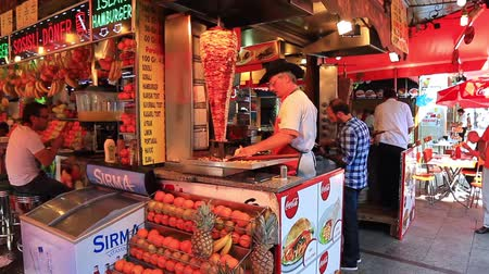 kebap : ISTANBUL - JUL 3: Man cooks and sells doner kebab in a small buffet at Eminonu region on July 3, 2013 in Istanbul. Doner kebab Stock Footage
