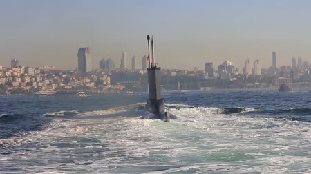 katonai : Riding on the wake of the submarine. Navy Submarine moving into Bosporus waters. Tracking shot.  Stock mozgókép