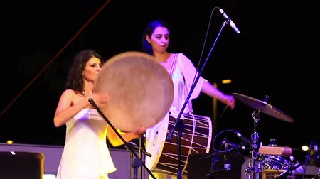 tambourine : ISTANBUL - JUL 14: Group KARDES TURKULER performs onstage at the annual Summer Festival events on the Maltepe open-air stage on July 14, 2012 in Istanbul. Kurdish folk song