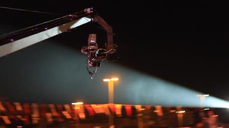 kino : Jimmy Jib Crane Camera in action at night concert Wideo