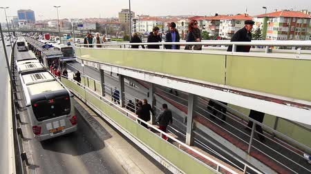 rendelenmiş : ISTANBUL - MAR 20, 2013: Incirli bus stop in Istanbul, Turkey. Metrobus line planed as a solution to transport problem with a daily capacity of 800,000 passengersday. Metrobus passing under overpass Stok Video