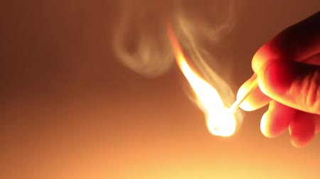 match : Man lights a match in darkness. Slow Motion, HD 1080