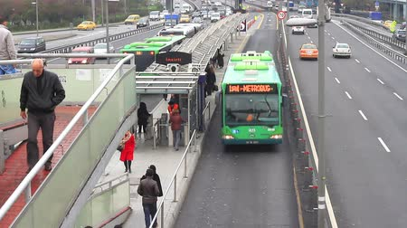 rendelenmiş : ISTANBUL - DECEMBER 16: Incirli bus stop with green Metrobus on December 16, 2010 in Istanbul. Metrobus line planed as a solution to transport problem with a daily capacity of 800,000 passengersday