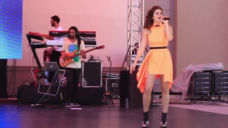 egemenlik : ISTANBUL - APRIL 22: Singer Atiye performs live for the children during National Sovereignty and Children Day on April 22, 2012 in Istanbul. Childrens Festival was first celebrated in Turkey on 1920. Singer in the orange dress