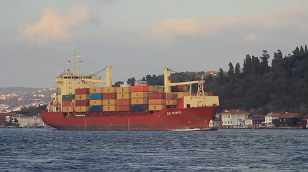 стек : Red Container ship. Cargo ship full of containers sails in Bosporus Sea in Istanbul.