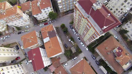 жилье : Aerial perspective of apartment buildings over suburban housing. Fly over slide shot from helicopter