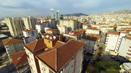 bydlení : Flying over houses along suburban architecture in Istanbul. Aerial view of residential blocks from low flying camera