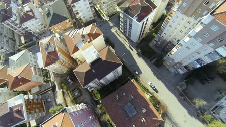 properties : Top down city blocks. Flying over streets and houses along suburban architecture in Istanbul. Aerial video of rooftops from flying camera.  Stock Footage