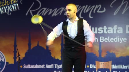 diabolo : ISTANBUL - SEPTEMBER 8: Juggler Kerem Eser performs his routine in Ramadan Month, September 8, 2010 in Istanbul. Sultanahmet most loved as the traditions of the month of fasting are alive in the city. Juggler Kerem Eser