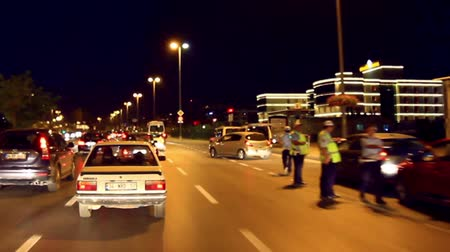 dui : ISTANBUL - SEP 19: Police officers stop cars at a DUI checkpoint on september 19, 2013 in Istanbul. Any driver who tests positive for drugs will lose his license and also be fined over 3,500 TL. Driving While Intoxicated Random Checkpoint Stock Footage