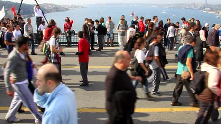 europe population : ISTANBUL - OCT 17: Crowd of people walk from Asia to Europe through Bosporus Bridge on October 17, 2010 in Istanbul. The participation was reported to be above expected figure of 100.000 people Stock Footage