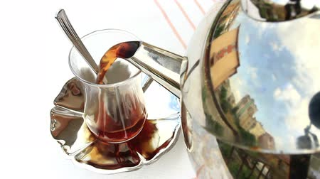tiered : Turkish Tea served from traditional 2 tiered teapot, bottom one for boiling water and top pot for brewed tea. Serving Turkish Tea  Stock Footage