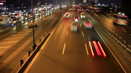 yolları : Time lapse busy light trail traffic on a freeway of Istanbul. Highway through city at night timelapse Stok Video