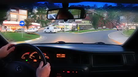 inside car : Driving car on a busy city street. POV from interior of car as it drives through city streets. Stock Footage