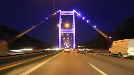 otoyol : Driving on the second bridge in Istanbul. Heavy highway traffic is very usual on Trans European Motorway (TEM). Drive by night across FSM Bridge. Timelapse View