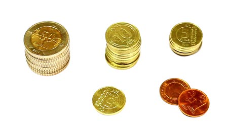 ekonomi : Stacks of Coins.  Camera pans over coins on white background. Panning Video, RL and LR Stok Video
