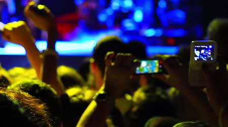 gece kulübü : ISTANBUL - SEP 18, 2011: Fans recording the rock concert.  Concert area on scene among excited spectators. Pop star Ajda Pekkan performs on stage at annual Summer Festival events Stok Video