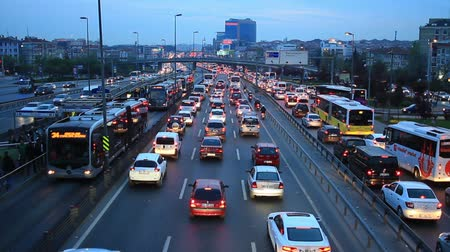 tarz : ISTANBUL - APR 4, 2014: Dense traffic in city. People lose 118 hours on average stuck in traffic annually. Congestion rate jumps to 80 percent during rush hours in the morning. Istanbul is working on large projects, including a channel for cars that will Stok Video