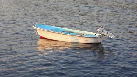 peaceful : Small motor boat on the silent sea Stock Footage